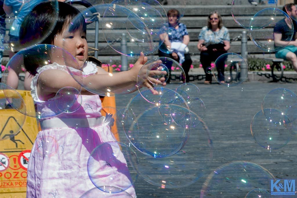 Prague: Blowing bubbles. They never last too long but for a moment